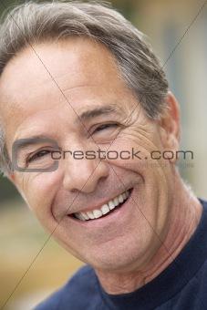 Portrait Of Senior Man Smiling At Camera