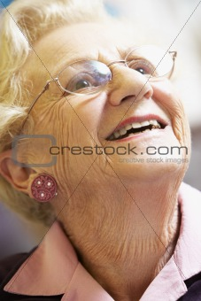 Portrait Of Senior Woman Smiling Happily