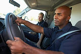 Ambulance driver and colleague on the way to an emergency