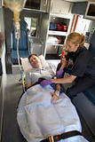 Paramedic with patient in ambulance