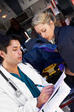Paramedic advising doctor about arriving patient