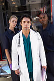 Portrait of doctor with two paramedics in front of ambulance