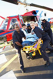 Paramedics unloading patient from Medevac