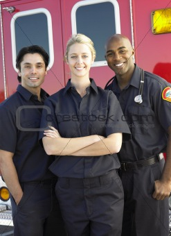 Portrait of paramedics standing in front of an ambulance