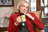 Senior woman drinking hot beverage