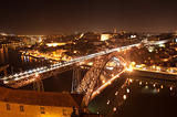 Dom Luis I Bridge illuminated at night. Oporto, Portugal  western