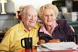 Senior couple having morning tea together