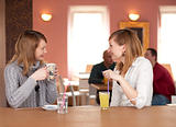 Girl chat - Two girls talking and drinking coffee