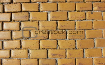 Old wall made from yellow bricks