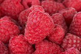 sweet raspberries closeup background