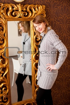 Beautiful girl infront of a mirror