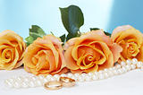 wedding roses with necklace and gold rings