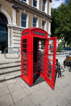 Old red telephone box in London