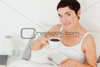 Close up of a woman drinking coffee
