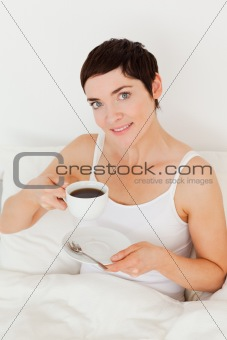 Cute woman drinking coffee