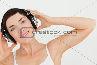 Close up of a lovely woman listening to music