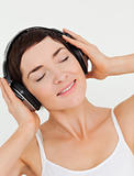 Portrait of a charming brunette listening to music
