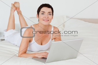 Close up of a woman using a laptop