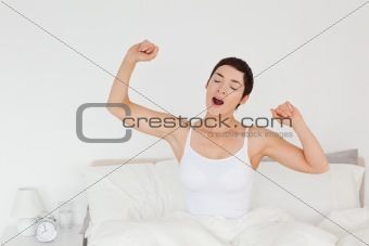 Close up of a woman stretching her arms