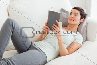 Beautiful brunette reading a book