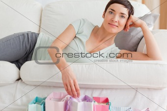 Close up of a lovely woman with shopping bags