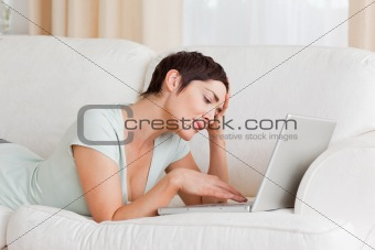Tired woman using a laptop