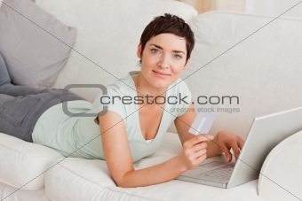 Cute woman shopping online