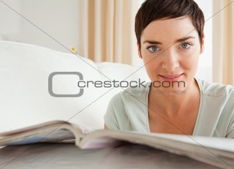 Close up of a cute woman with a magazine