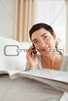 Potrait of a woman with a magazine calling