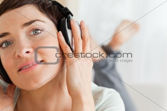 Close up of a brunette listening to music