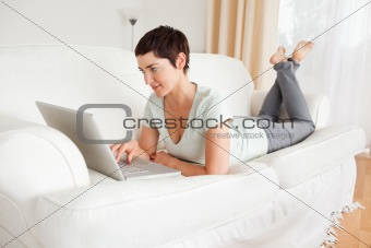 Happy short-haired woman using a laptop