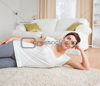 Cute woman lying on a carpet