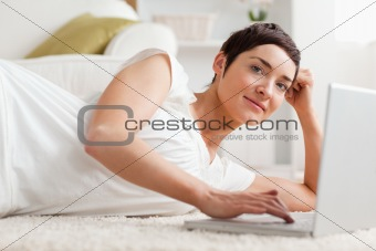 Close up of a quiet woman with a laptop