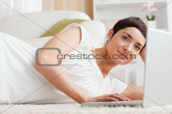 Close up of a serious woman with a laptop