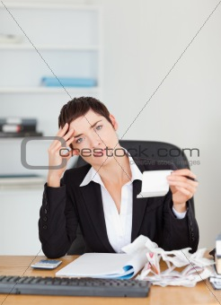 Portrait of an accountant checking receipts