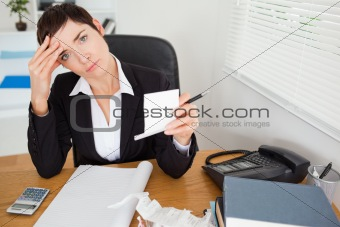 Female accountant checking receipts