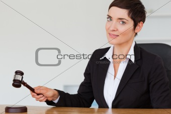 Woman knocking a gavel