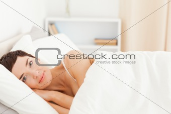 Cute woman waking up
