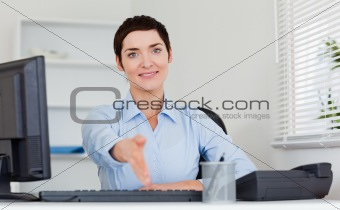 Smiling business woman giving her hand
