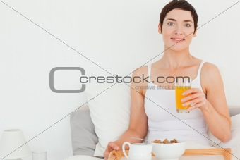 Close up of a woman drinking orange juice