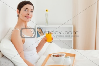 Close up of a woman drinking juice