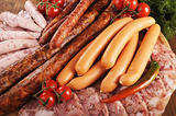 different types of sausages with cherry tomato