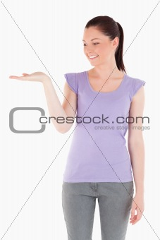 Charming woman showing a copy space