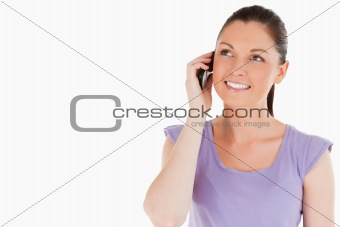 Attractive woman on the phone while standing