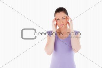 Beautiful woman having a headache while standing