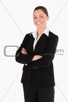 Beautiful woman in suit posing while standing