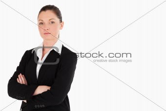 Attractive woman in suit posing while standing