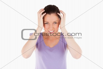 Attractive woman having a migraine while standing