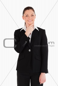 Cute woman in suit posing