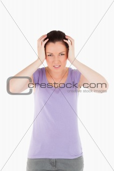 Charming woman having a migraine while standing